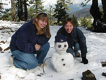 Lucy and Debbie with a snowman in the Troodos Mountains