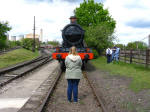 Lucy standing in the path of 5322 at the Didcot Railway Centre