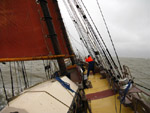 Setting the topping-lift on schooner Trinovante