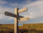 Signpost at the northern end of the Peddars Way where it meets the Norfolk Coast Path