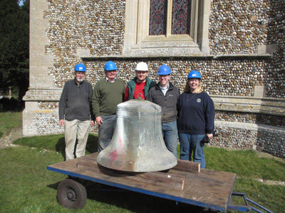 Some of the Woolpit bellringers with the tenor bell