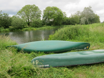 Canoes by the River Bure in Buxton